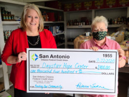 SACFCU's president - Patty Sarne presenting a check for $1,400 to Daystar Hope Center