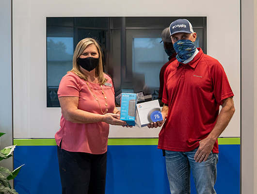 Picture of SACFCU's 2020 Debit Card Contest winner along with one of SACFCU's office managers.