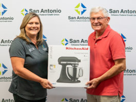Dade City Branch Manager along with the winner of SACFCU's Mobile Banking Contest. Both of them are holding up the price of a Kitchenaid Stand Mixer