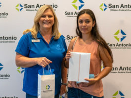 Picture of the Dade City office Area Manager, Tammy Minton presenting Sandra Gonzalez with an iPad