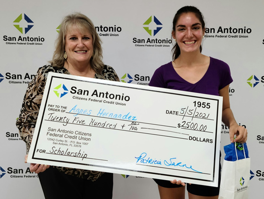 Picture of SACFCU's CEO presenting Agnes Hernandez with a $2,500 Scholarship check