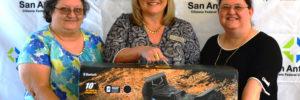 SACFCU's Debit Card Contest Winner holding Swagtron Smart Board