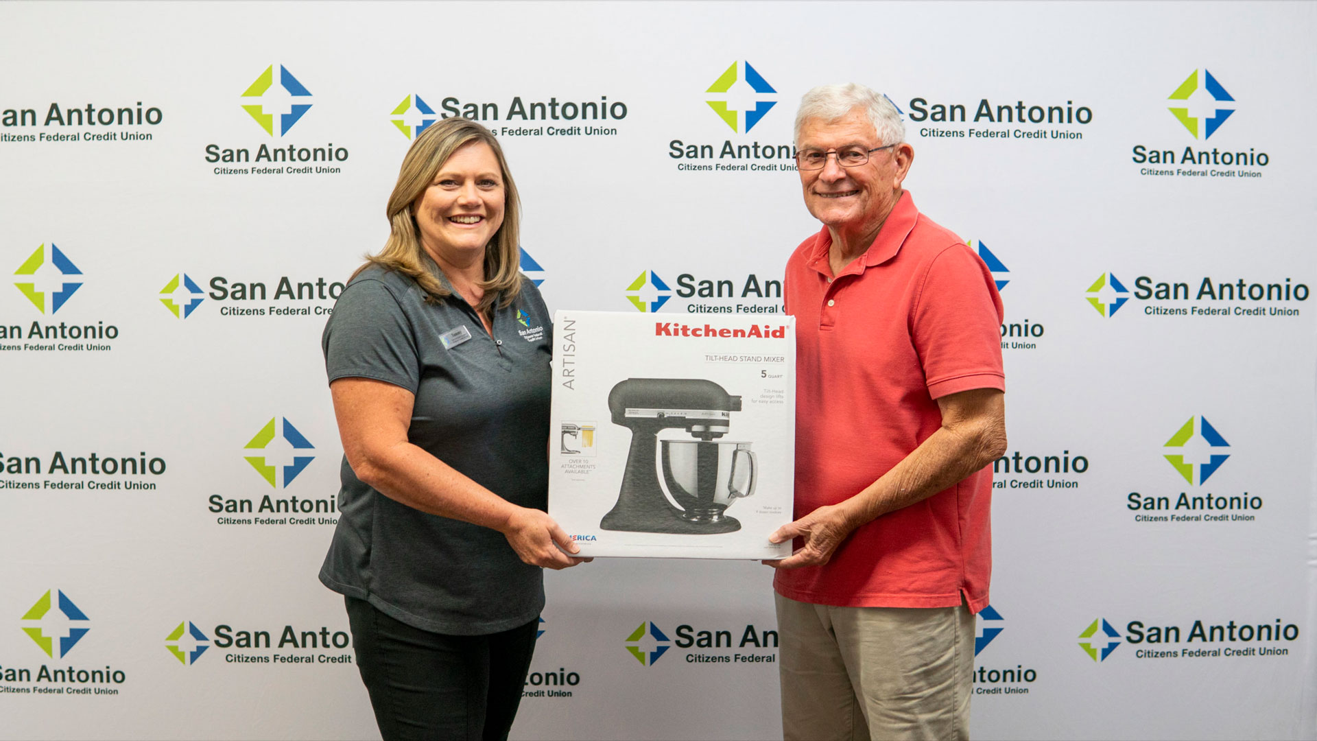 Dade City Branch Manager along with the winner of SACFCU's Mobile Banking Contest holding up the prize of a Kitchenaid Stand Mixer