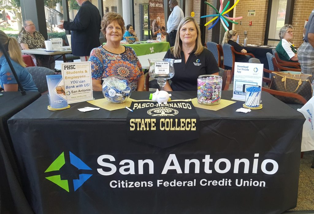 Picture of two SACFCU employees at the Pasco Hernando State College Student Resource Fair