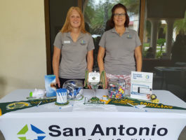 Employees manning our table at the Fall Vendor Fair
