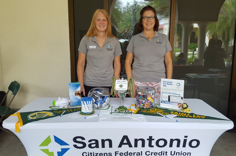 Picture of two SACFCU Employees at the Saint Leo University Fall Vendor Fair.