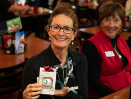 Picture of a raffle winner at the Zephyrhills Chamber Christmas Breakfast
