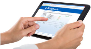 Close-up Of A Person Viewing E-Statements On Digital Tablet