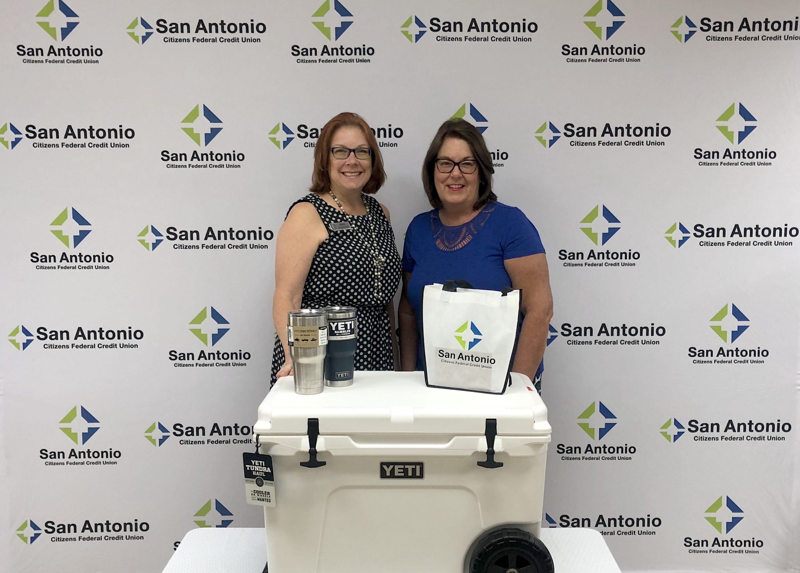 Winner of an SACFCU employee presenting a Yeti Cooler to the 2020 eStatement Contest winner.